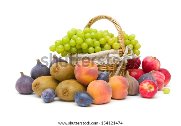a basket of ripe green grapes and other fruit isolated on a white background. horizontal photo.