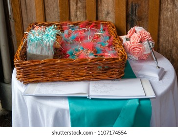 Basket set up with wedding party favors along side the guest book.
