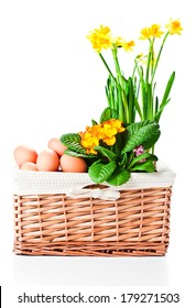 basket with spring flowers and eggs  isolated on white