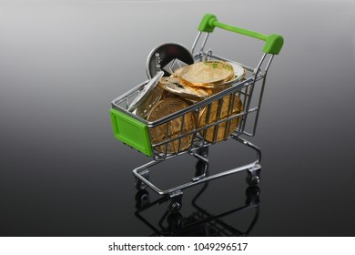 Basket from supermarket with coins crypto currency e bitcoin etherium litetcoin on a black gray background with reflection exchange purchase sale exchanger closeup.