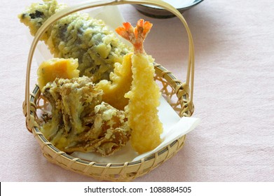 a basket of tempura.  Tempura is Japanese dish usually consisting of seafood or vegetablthat have been battered and deep fried. The dish was influenced by fritter-cooking  techniques .