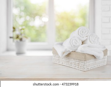 Basket with towels on window sill over summer day background