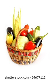 Basket of vegetables isolated on white