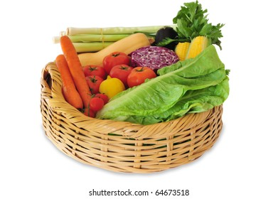 A basket of vegetables isolated on white
