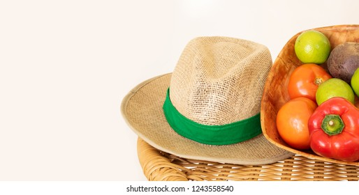 Basket of vegetables and straw hat on the table. Agriculture con