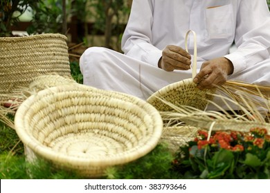 Basket weaving using the dried dates palm leaves, a village industry in Bahrain.