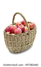 basket of willow twigs with ripe red apples