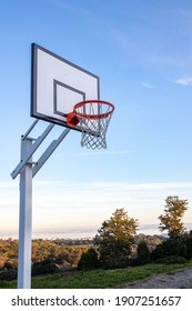 Basketball backboard on Monsanto's Natural Park, in Lisbon. With trees and blue sky in the background.