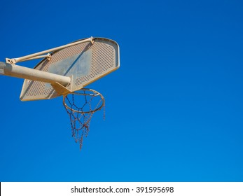 basketball backboard on sunny sky blue day on the beach