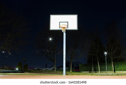 Basketball backboard in a urban park, winter night