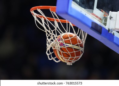 Basketball ball, board and net on black background