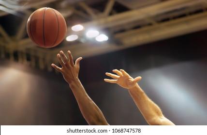 Basketball ball flies over the basketball court