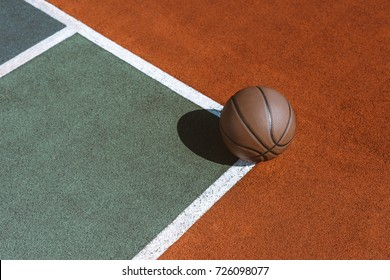 Basketball ball on the ground at sports field