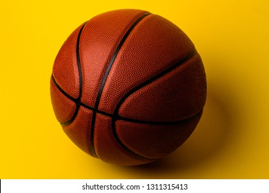 basketball ball on yellow background.