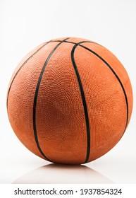Basketball ball over white background. Orange ball, sports concept.