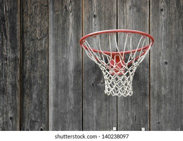 a basketball basket on weathered wooden facade