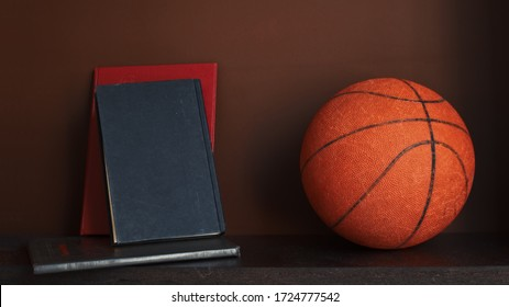 Basketball and books on wooden shelf