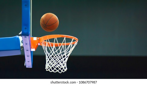 The basketball bounces off the basketball Board and flies into the basket. On the right of the photo there is a place for text