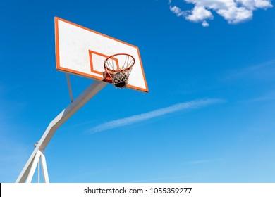 basketball close up, basketball bal in hoop at sunny day