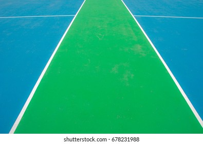 The basketball court flooring, green, and blue.