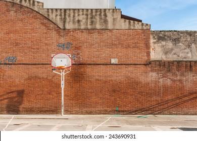 Basketball court with old ring outdoor in Sant Feliu de Llobregat, Barcelona, Spain