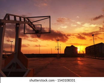 Basketball Court with Sunset Background