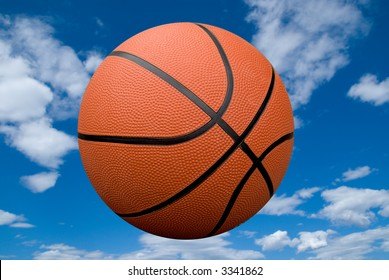 Basketball floating in the air with a cloudy sky background