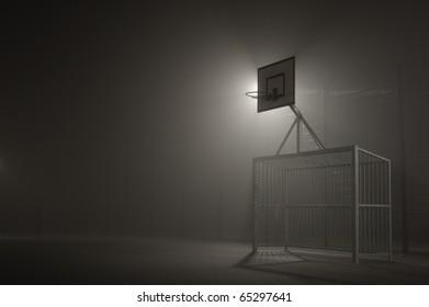Basketball and football field at night in the fog