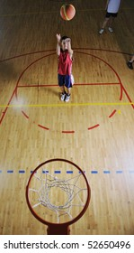 basketball game playeer shooting on basket indoor in gym