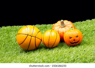 Basketball Halloween with pumpkin are on green grass