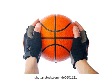Basketball in hand on isolated background
