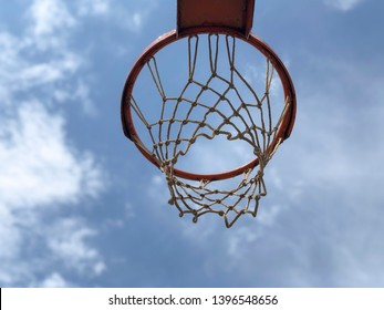 A basketball hoop against blue sky