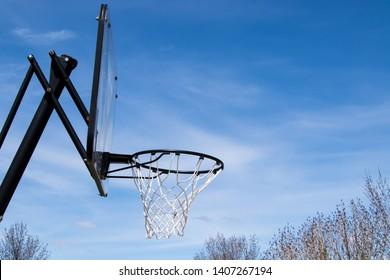 Basketball hoop against a blue sky background.