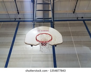 basketball hoop with backboard saying no dunking