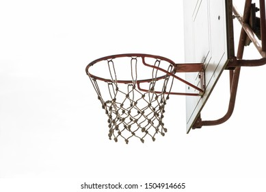 Basketball hoop, basket with white net and white blown up sky in background