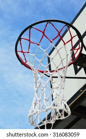 basketball hoop and blue sky background