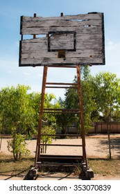 Basketball hoop is broken and wood board damaged ,Shiny wooden basketball