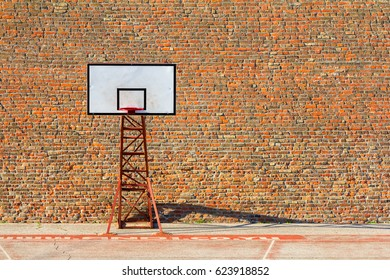 basketball hoop and court abstract, with a red textured brick wall background