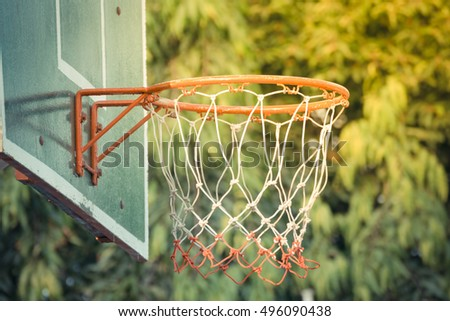 Basketball hoop make by wooden and ball in park , process in vintage style