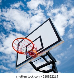 Basketball hoop on blue sky and clouds