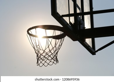Basketball hoop on basketball court under syn