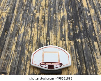 Basketball hoop on old wooden barn
