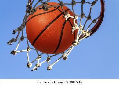 Basketball hoop shoot on a blue sky
