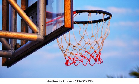 basketball hoop in sky background on evening