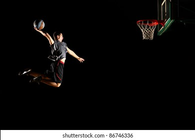 Basketball jump isolated on black background