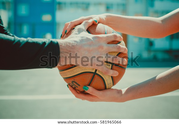basketball male and female hands