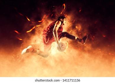Basketball man player. Basketball concept on flames background – Image