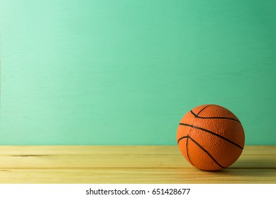 Basketball model over green wooden background - Sport competition concept