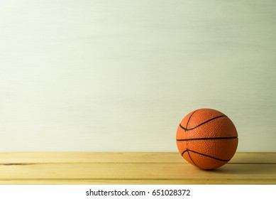 Basketball model over white wooden background - Sport competition concept