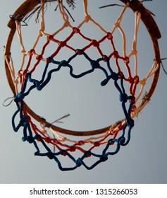 A basketball nylon nets with blue sky background photo
